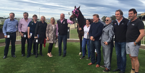 DOWNLOADINGTrainer Rob Heathcote and connections celebrate at Doomben