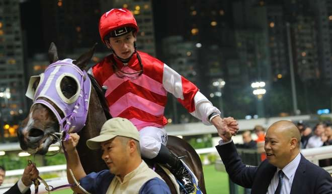 YO-YO DATrainer Chris So welcomes his Danerich winner back to scale in Hong Kong